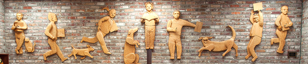 beautiful artistic wooden carvings of children displayed at Bolivar County Library System